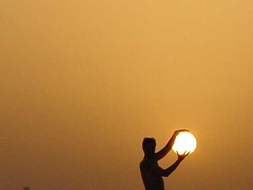 man-holding-sun